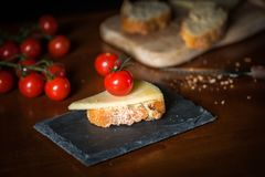 Cheese with cherry stock images