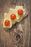 Light Sandwich With Edam Cheese Slices And Cherry Tomatoes Set On Old Knotted Rough Pine Wood Table Surface Stock Photography