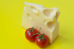 Cheese and cherry tomatoes Stock Photos