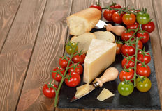 Cheese and cherry tomatoes Stock Image