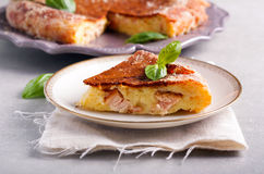 Cheese and chicken quiche slice Stock Photos