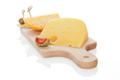 Cheese on chopping board isolated. Royalty Free Stock Photo