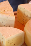 Cheese closeup. Closeup of sections of cheese on display at market Royalty Free Stock Photo