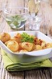 Cheese coated potatoes Stock Photos