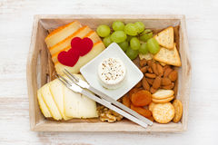 Cheese with cookies, grape Royalty Free Stock Image