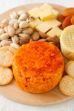 Cheese with cookies Stock Photography