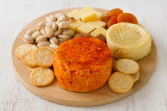 Cheese with cookies Royalty Free Stock Photo