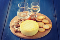 Cheese with cookies, nuts and wine Royalty Free Stock Images