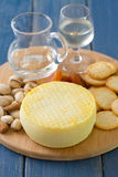 Cheese with cookies, nuts and wine Royalty Free Stock Photos