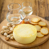 Cheese with cookies, nuts and wine Royalty Free Stock Photo