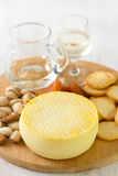 Cheese with cookies, nuts and wine on tray Royalty Free Stock Photo
