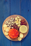 Cheese with cookies and nuts Royalty Free Stock Images