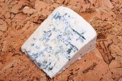 Cheese on cork Stock Photo
