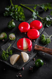 Cheese covered with red wax Royalty Free Stock Images