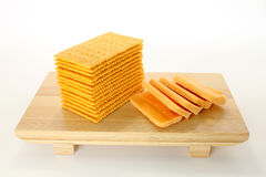 Cheese and Crackers. Crackers and cheese slices on bamboo tray; white background Royalty Free Stock Photography