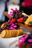 Cheese and crackers. An appetizer selection of cheese, crackers, grapes and strawberries Stock Image