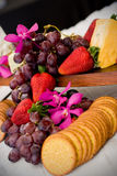 Cheese and crackers. An appetizer selection of cheese, crackers, grapes and strawberries Royalty Free Stock Photo
