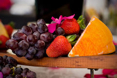 Cheese and crackers. An appetizer selection of cheese, crackers, grapes and strawberries Royalty Free Stock Image
