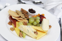 Cheese and crackers. A restaurant serving of cheese and biscuits Stock Photo