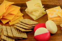 Cheese and crackers. Assortment of cheeses and crackers on a wood server Stock Photography