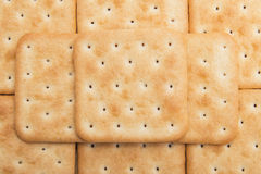 Cheese crackers background. Texture of cookies Stock Image