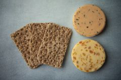 Cheese and crackers. On a blue background royalty free stock photos