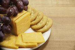 Cheese and Crackers with Grapes on Plate Stock Photo