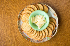 Cheese and crackers on a plate. A snack plate of cheese and crackers from above Stock Photo