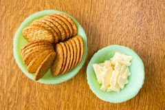 Cheese and crackers snack. Green vintage depression glass bowls full of a snack of crackers and cheese Royalty Free Stock Photos