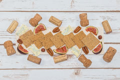 Cheese and crackers with wine corks Stock Photos