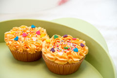 Cheese cream cupcakes with sprinkled marble topping stock images