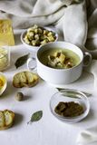 Cheese cream soup on a white background. White bread croutons. Ingredients stock photo