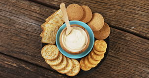 Cheese with crispy biscuits and bread. On tray stock footage
