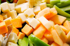 Cheese cubes. Close up of yellow and orange cheese cubes Royalty Free Stock Images