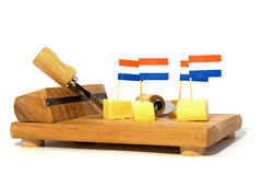 Cheese cubes on wooden board Stock Photos