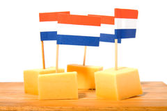 Cheese cubes on wooden board Royalty Free Stock Photo