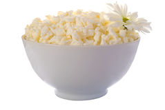 Cheese In Cup And Flowers. Royalty Free Stock Photography