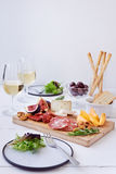 Cheese and cured meat board Stock Photos