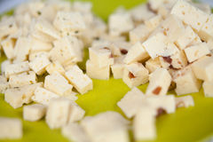 Cheese cut into dices Royalty Free Stock Images