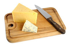 Cheese on cutting board Stock Photo