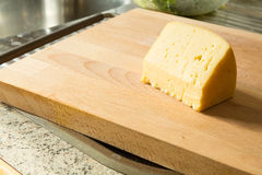 Cheese on a cutting board Stock Image