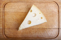 Cheese on a cutting board Stock Photos