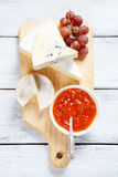 Cheese on a cutting board with jam Royalty Free Stock Photography