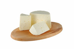 Cheese on cutting board Stock Image