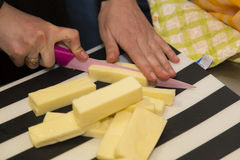 Cheese. Cutting some cheese in slices Stock Photo