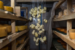 Cheese at the dairy, cheese is ripen on racks. Cheese at the dairy, cheese is ripen on wood racks Stock Images