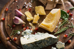 Cheese delikatessen closeup on rustic wood, blue roquefort and parmesan Stock Photo