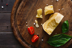 Cheese delikatessen closeup on rustic wood, parmesan Royalty Free Stock Images