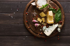 Cheese delikatessen on rustic wood, blue roquefort, brie and parmesan Royalty Free Stock Image