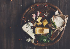 Cheese delikatessen on rustic wood, blue roquefort, brie and parmesan Royalty Free Stock Photo